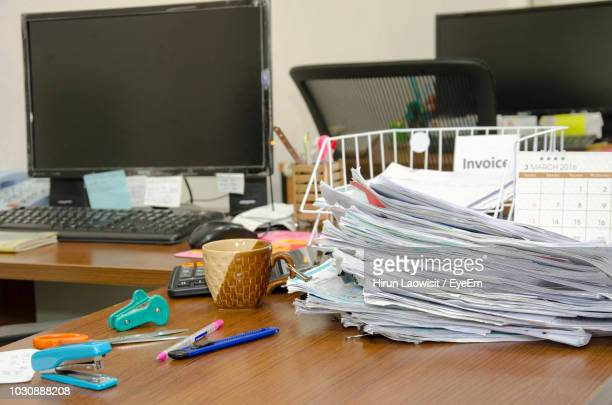 papers and computer with office supplies on desk - messy stock pictures, royalty-free photos & images