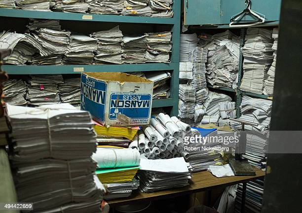 Papers and files are piled in a storage room at a cultural center March 4 2014 in New Delhi India