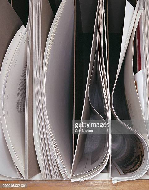 Papers in cubbyholes, close-up