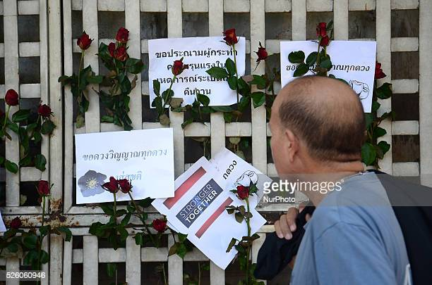 Papers with good words and roses are seen near the Erawan Shrine in Bangkok, Thailand on August 18, 2015. In the evening on August 17, The bomb blast...
