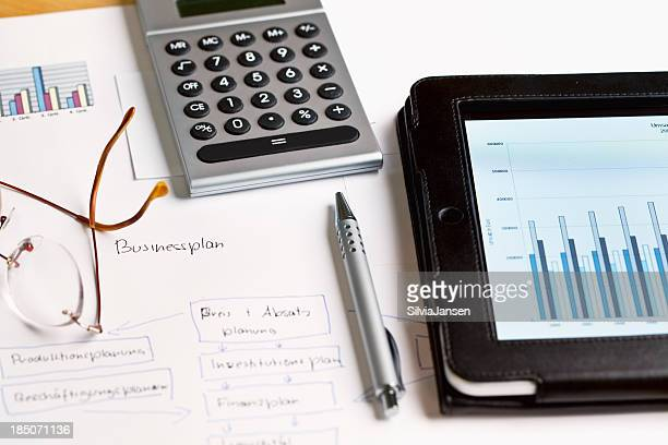 paperwork business plan calculation with digital tablet