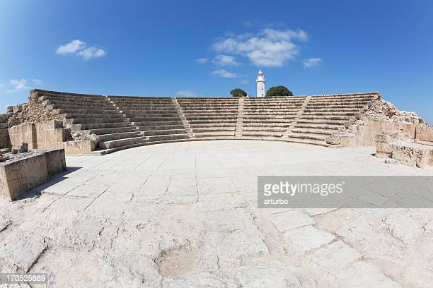 Paphos amphitheater and white lighthouse against blue sky Cyprus