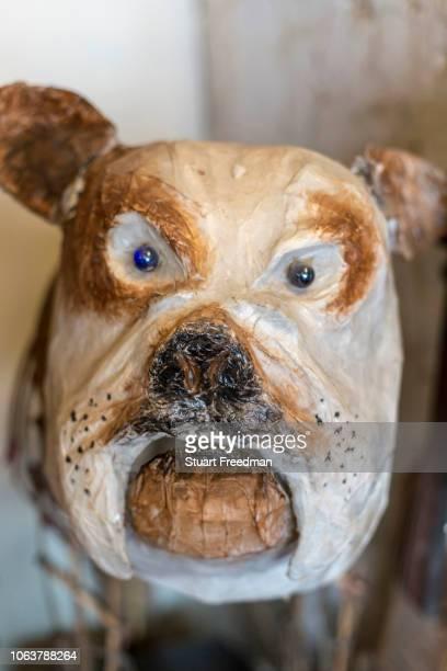 A papier mache dog at The People Tree boutique Champa Gali New Delhi India Champa Gali is the latest and most intimate of Delhi's urban creative...