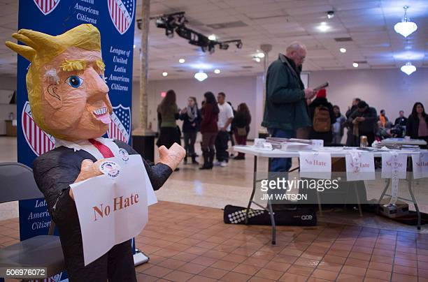 A papier mache doll of Republican presidential candidate Donald Trump stands near the League of United Latin American Citizens of Iowa 's table...