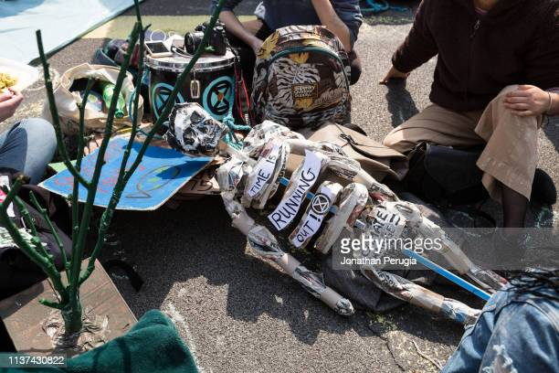 A papier mache skeleton lies in the road during a protest against climate change in Piccadilly Circus on 15th April 2019 in London United Kingdom...
