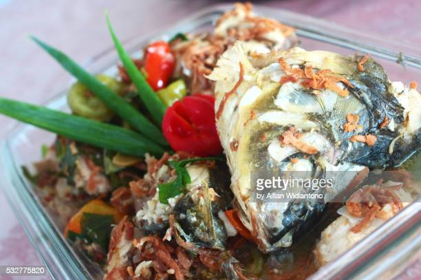 pa'piong, indonesian dish from toraja highland - rantepao stock photos and pictures