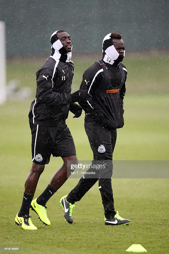 Papis Cisse (left) and Cheik Tiote (right) during a Newcastle United Training Session at the Little Benton training ground on February 13, 2013 in Newcastle upon Tyne, England.