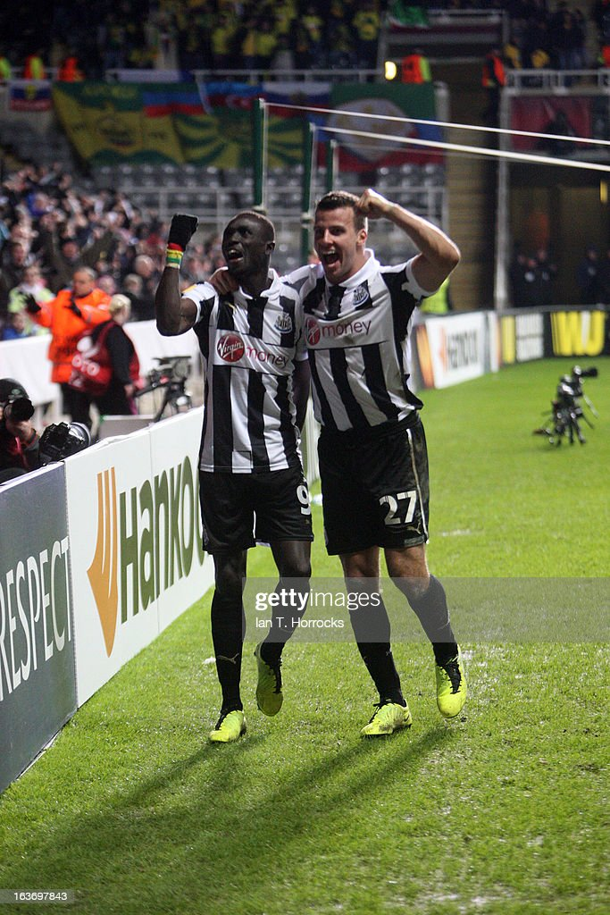 Papis Cisse of Newcastle United (L) celebrates with Steven Taylor after scoring the only goal during the UEFA Europa League Round of 16 second leg match between Newcastle United FC and FC Anji Makhachkala at St James' Park on March 14, 2013 in Newcastle upon Tyne, England.