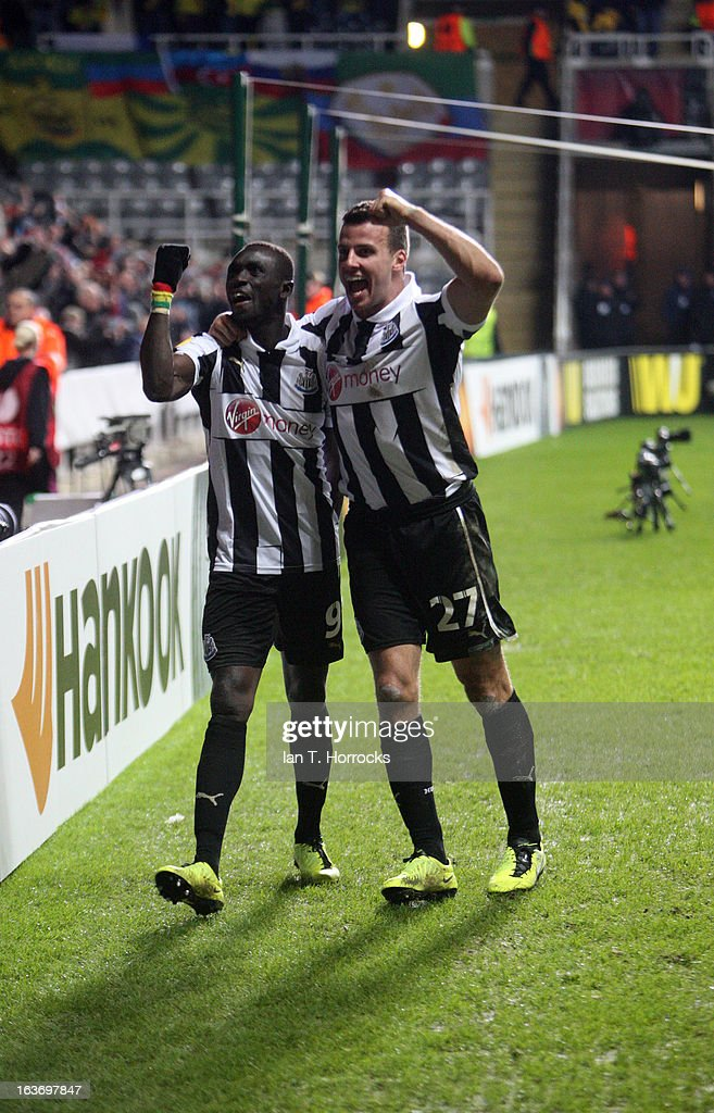 Papis Cisse of Newcastle United (left) celebrates with Steven Taylor after scoring the only goal during the UEFA Europa League Round of 16 second leg match between Newcastle United FC and FC Anji Makhachkala at St James' Park on March 14, 2013 in Newcastle upon Tyne, England.
