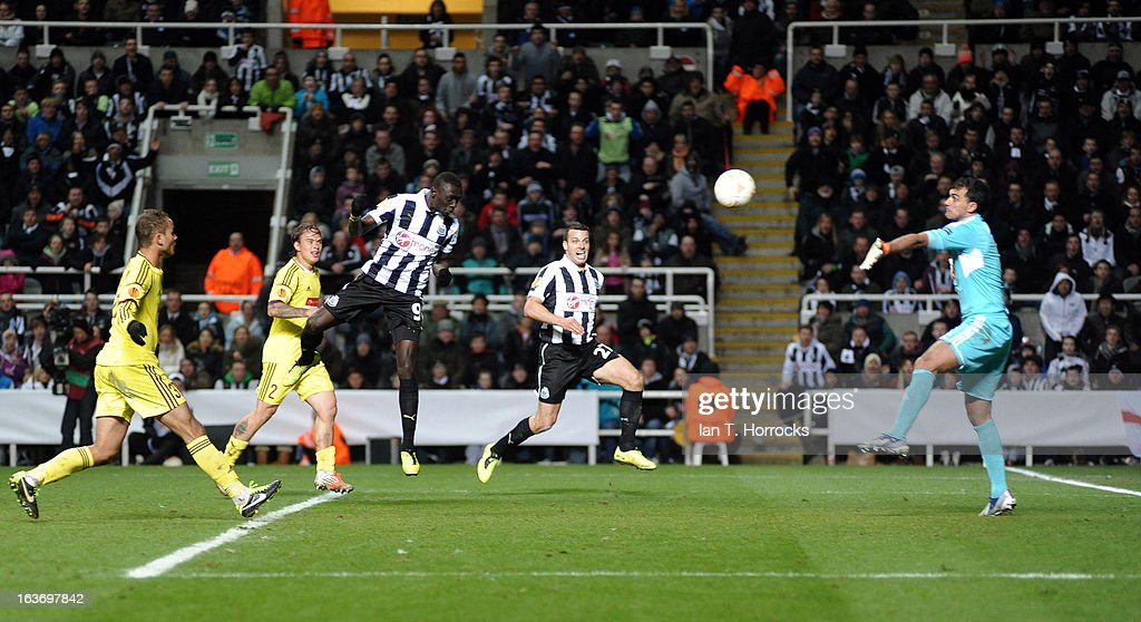Papis Cisse of Newcastle United scores the only goal during the UEFA Europa League Round of 16 second leg match between Newcastle United FC and FC Anji Makhachkala at St James' Park on March 14, 2013 in Newcastle upon Tyne, England.