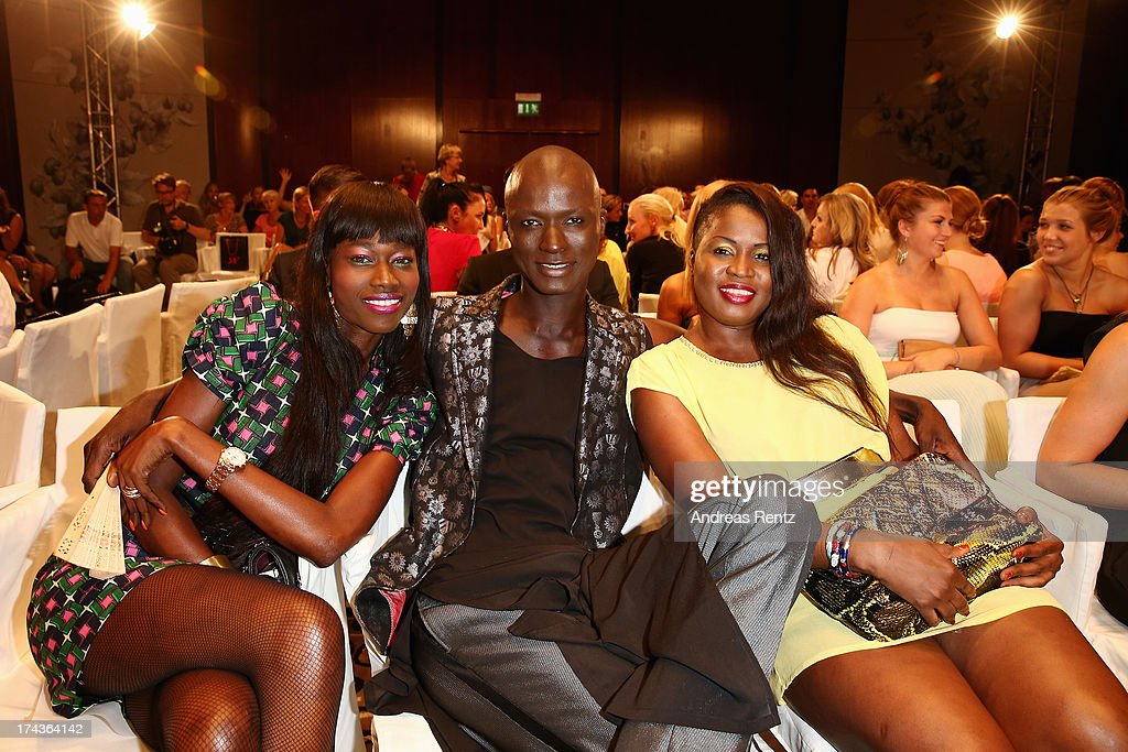 Papis Loveday and his sisters Coumba (L) and Sally (R) attend the Marcel Ostertag fashion show at Charles Hotel on July 24, 2013 in Munich, Germany.