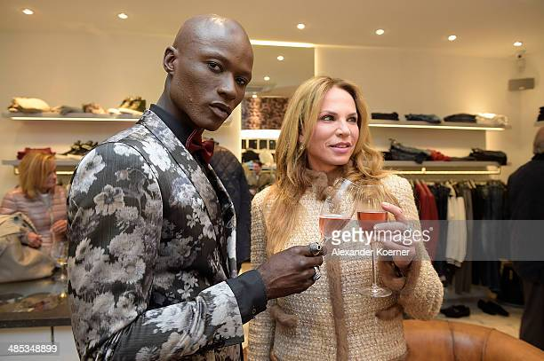 Papis Loveday and Rosalie van Breemen attend the reopening of the Different Fashion store on April 17 2014 in Kampen Germany
