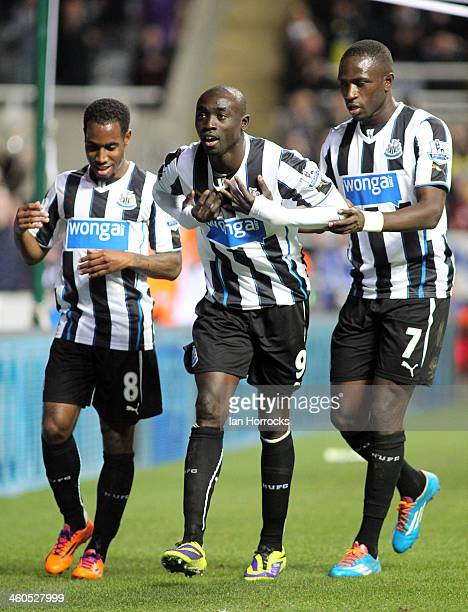 Papiss Cisse flanked by Vurnon Anita and Moussa Sissoko of Newcastle United celebrate the opening goal during the Budweiser FA Cup third round match...