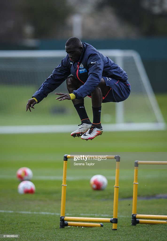 Papiss Cisse jumps over training hurdles during the Newcastle United Training session at The Newcastle United Training Centre on April 8, 2016 in Newcastle upon Tyne, England.