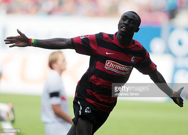 Papiss Cisse of Freiburg celebrates after scoring his team's first goal during the Bundesliga match between FC Augsburg and SC Freiburg at SGL Arena...