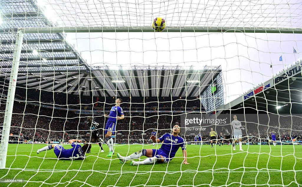Papiss Cisse of Newcastle celebrates after scoring the second goal as Chelsea defender John Terry (floor) looks on during the Barclays Premier League match between Newcastle United and Chelsea at St James' Park on December 6, 2014 in Newcastle upon Tyne, England.