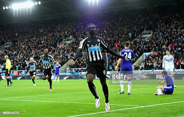 Papiss Cisse of Newcastle celebrates after scoring the second goal during the Barclays Premier League match between Newcastle United and Chelsea at...