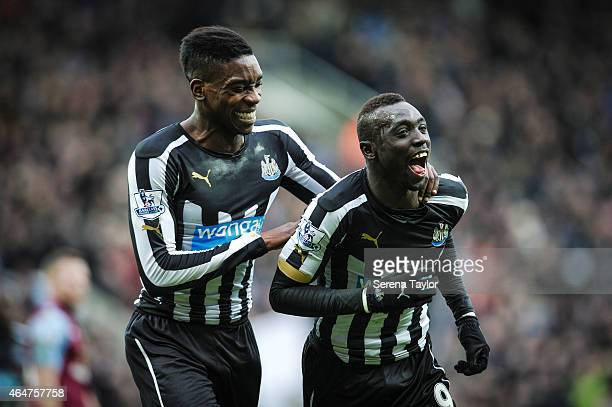 Papiss Cisse of Newcastle celebrates with teammate Sammy Ameobi after scoring the opening goal during the Barclays Premier League Match between...