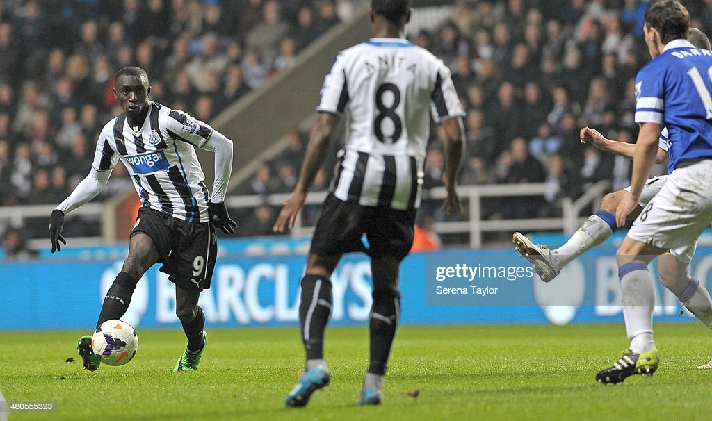 Papiss Cisse of Newcastle (no9) controls the ball during the Barclays Premier League match between Newcastle United and Everton at St. James' Park on March 25, 2014, in Newcastle upon Tyne, England.