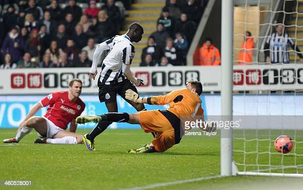 Papiss Cisse of Newcastle scores the first goal during the Budweiser FA Cup third round match between Newcastle United and Cardiff City at St. JamesÕ...