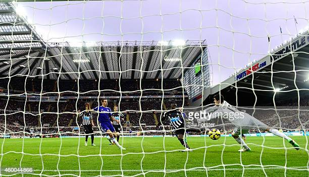 Papiss Cisse of Newcastle scores the opening goal past Thibaut Courtois of Chelsea during the Barclays Premier League match between Newcastle United...