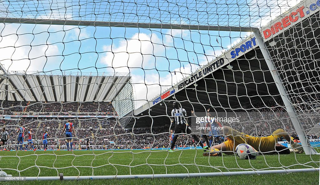 Papiss Cisse (4th L) of Newcastle scores the winning goal past Crystal Palace goal keeper Julien Speroni during the Barclays Premier League match between Newcastle United and Crystal Palace at St. James' Park on March 22, 2014, in Newcastle upon Tyne, England.