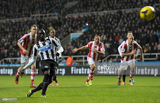 Papiss Cisse of Newcastle scores their fifth goal from the penalty spot during the Barclays Premier League match between Newcastle United and Stoke...
