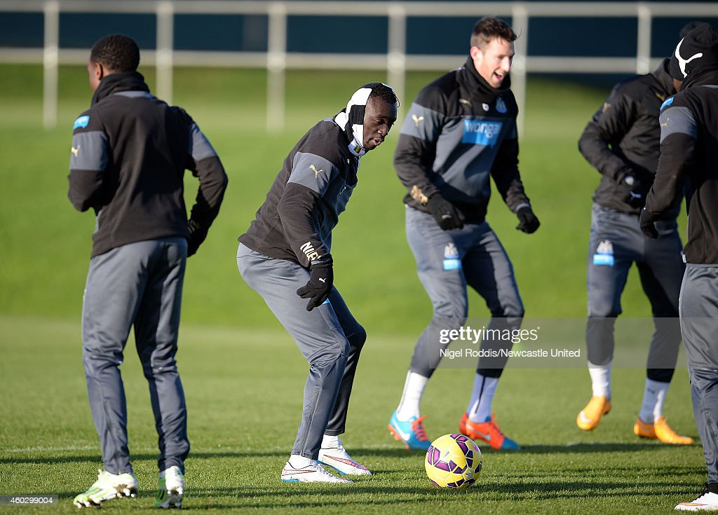 Papiss Cisse (2ndL) of Newcastle United during a training session at The Newcastle United Training Centre on December 11, 2014 in Newcastle upon Tyne, England.
