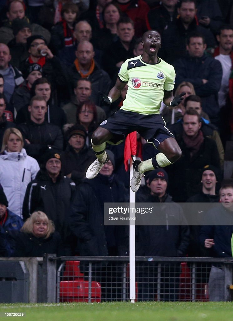 Papiss Cisse of Newcastle United leaps into the air to celebrate scoring his teams third goal during the Barclays Premier League match between Manchester United and Newcastle United at Old Trafford December 26, 2012 in Manchester, England.