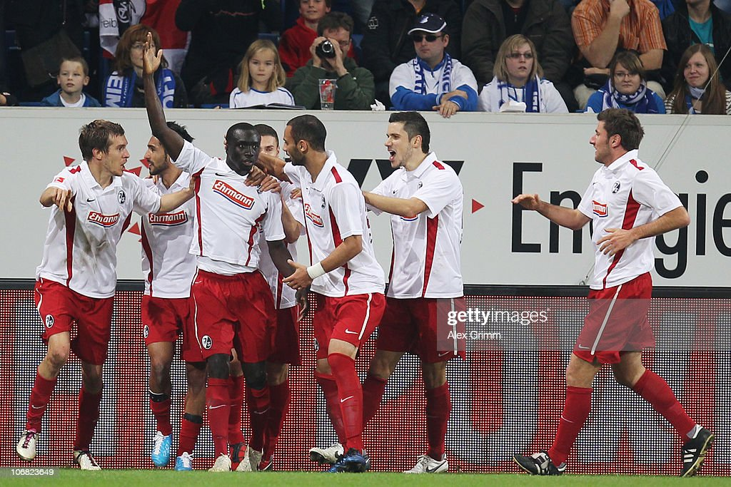 Papiss Demba Cisse (3L) of Freiburg celebrates his team's first goal with team mates during the Bundesliga match between 1899 Hoffenheim and SC Freiburg at the Rhein-Neckar Arena on November 14, 2010 in Sinsheim, Germany.