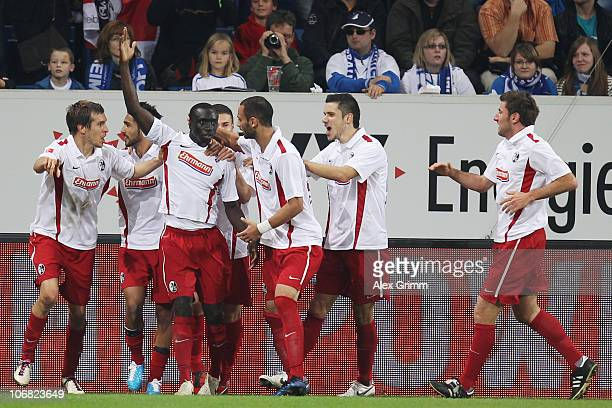 Papiss Demba Cisse of Freiburg celebrates his team's first goal with team mates during the Bundesliga match between 1899 Hoffenheim and SC Freiburg...