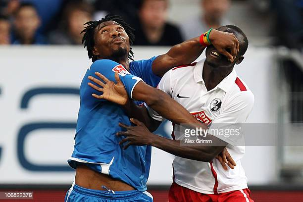 Papiss Demba Cisse of Freiburg is challenged by Isaac Vorsah of Hoffenheim during the Bundesliga match between 1899 Hoffenheim and SC Freiburg at the...