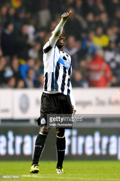 Papiss Demba Cisse of Newcastle celebrates after scoring the opening goal during the Budweiser FA Cup third round match between Newcastle United and...
