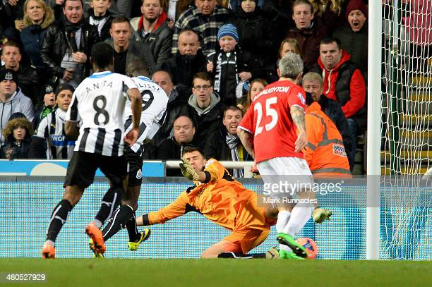 Papiss Demba Cisse of Newcastle scores the opening goal past goalkeeper David marshall of cardiff during the Budweiser FA Cup third round match...