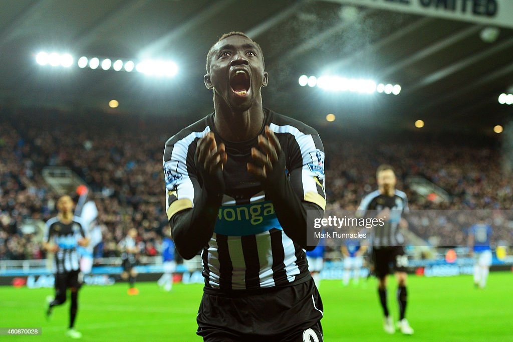 Papiss Demba Cisse of Newcastle United celebrates after scoring a goal to level the scores at 1-1 during the Barclays Premier League match between Newcastle United and Everton at St James' Park on December 28, 2014 in Newcastle upon Tyne, England.