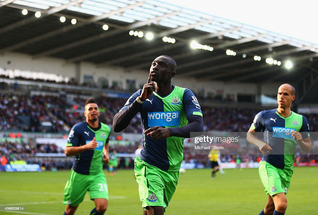 Papiss Demba Cisse of Newcastle United (C) celebrates as he scores their second goal during the Barclays Premier League match between Swansea City and Newcastle United at Liberty Stadium on October 4, 2014 in Swansea, Wales.