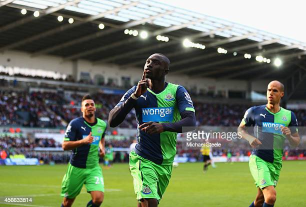 Papiss Demba Cisse of Newcastle United celebrates as he scores their second goal during the Barclays Premier League match between Swansea City and...