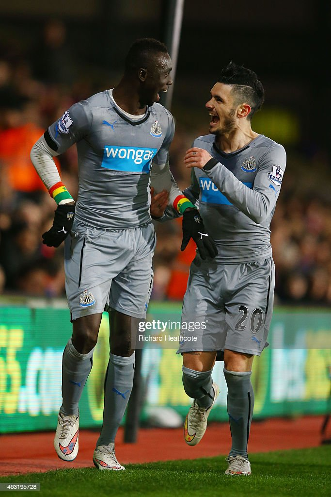 Papiss Demba Cisse of Newcastle United celebrates scoring the opening goal with Remy Cabella of Newcastle United during the Barclays Premier League match between Crystal Palace and Newcastle United at Selhurst Park on February 11, 2015 in London, England.
