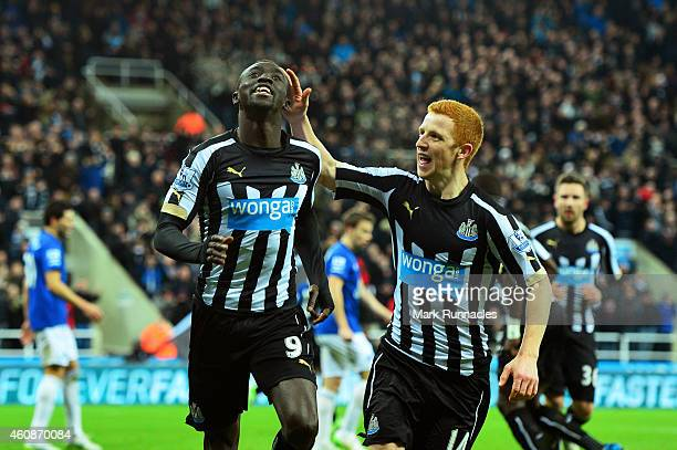 Papiss Demba Cisse of Newcastle United celebrates with teammate Jack Colback after scoring a goal to level the scores at 1-1 during the Barclays...
