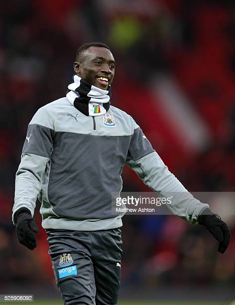 Papiss Demba Cisse of Newcastle United with a personalised black and white snood with the national flag of Senegal