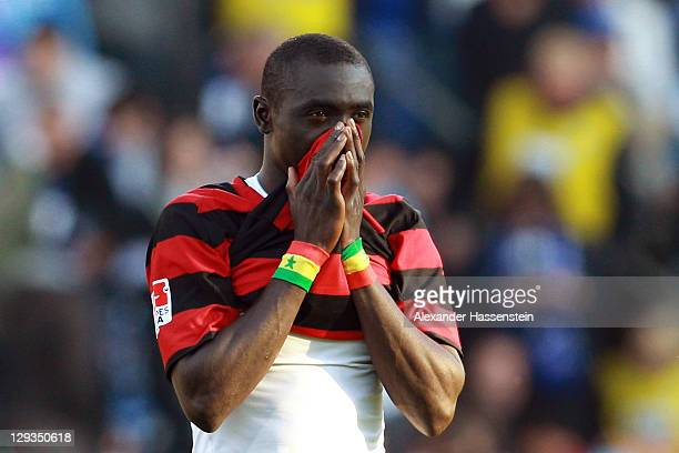 Papisse Cisse of Freiburg reacts after loosing the Bundesliga match between SC Freiburg and Hamburger SV at badenova Stadium on October 16 2011 in...