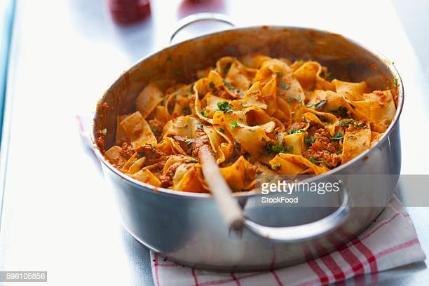 Pappardelle bolognese in a saucepan