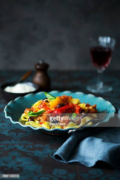 pappardelle with peppers and salsiccia (italian sausage) - olive pimento stock photos and pictures
