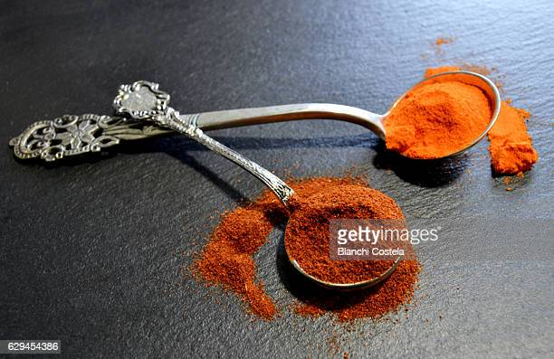 paprika in silver teaspoons - paprika stock pictures, royalty-free photos & images
