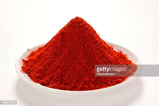 paprika on plate - paprika stock pictures, royalty-free photos & images