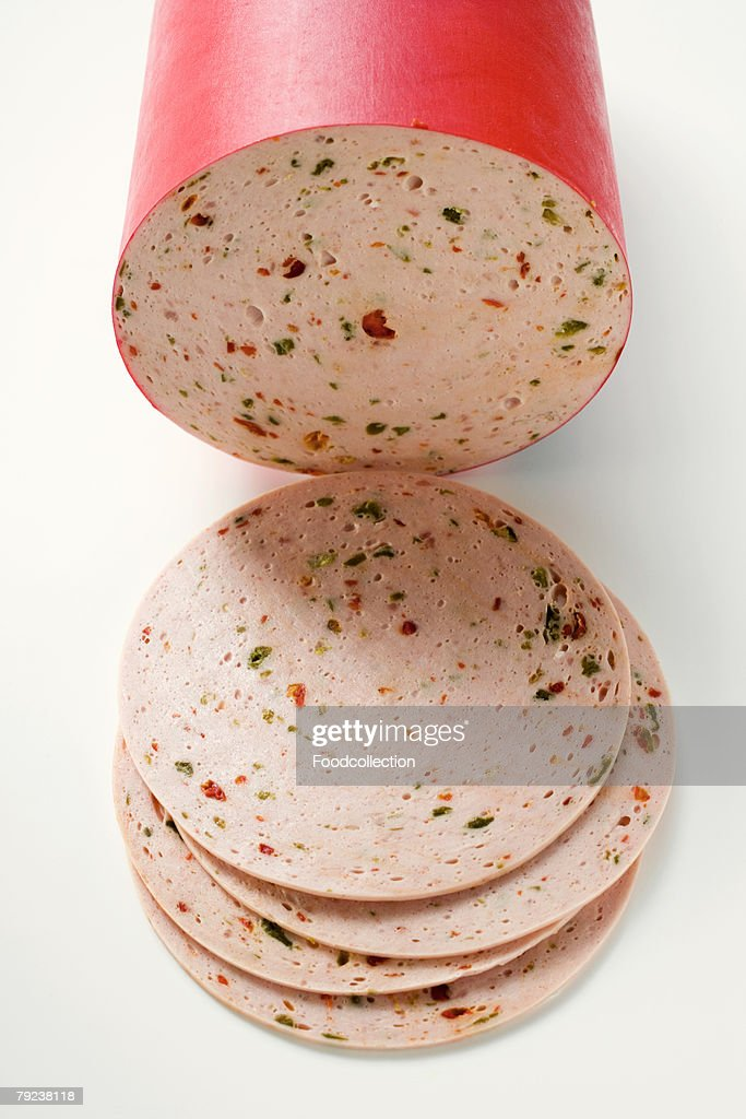 Paprikawurst (pepper sausage), a piece and slices : Stock Photo