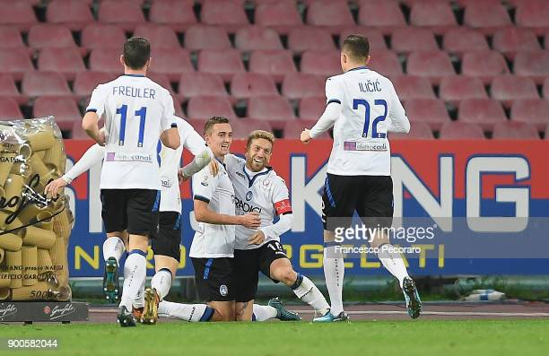 Papu Gomez and Timothy Castagne of Atalanta BC celebrate the 02 goal scored by Papu Gomez during the TIM Cup match between SSC Napoli and Atalanta BC...
