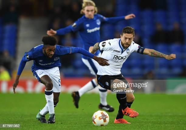 Papu Gomez of Atalanta and Beni Baningime of Everton battle for possession during the UEFA Europa League group E match between Everton FC and...