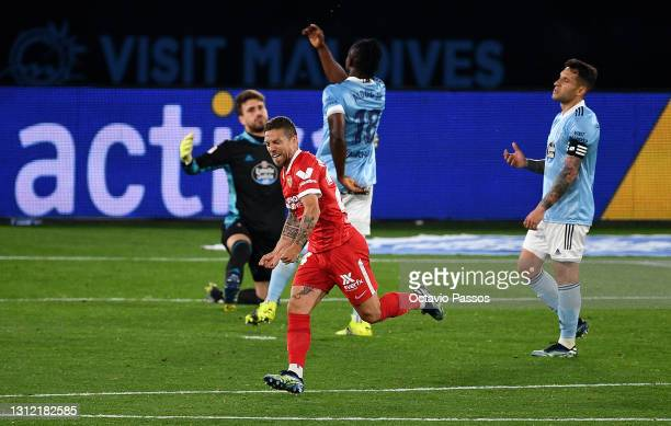Papu Gomez of Sevilla celebrates after scoring their sides fourth goal during the La Liga Santander match between RC Celta and Sevilla FC at...