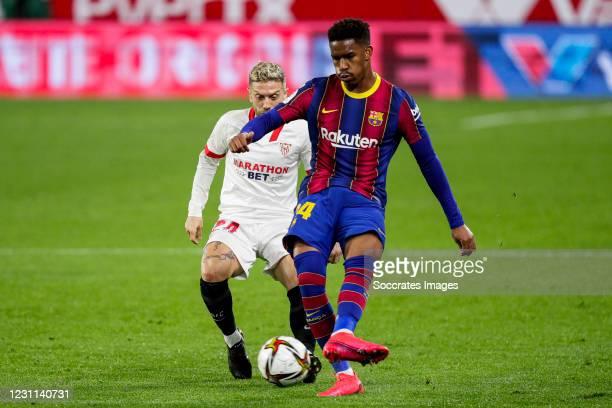 Papu Gomez of Sevilla FC, Junior Firpo of FC Barcelona during the Spanish Copa del Rey match between Sevilla v FC Barcelona at the Estadio Ramon...